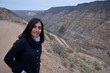Woman posing in the Atuel River Canyon, San Rafael, Mendoza, Argentina
