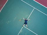 Tennis man player lay on court