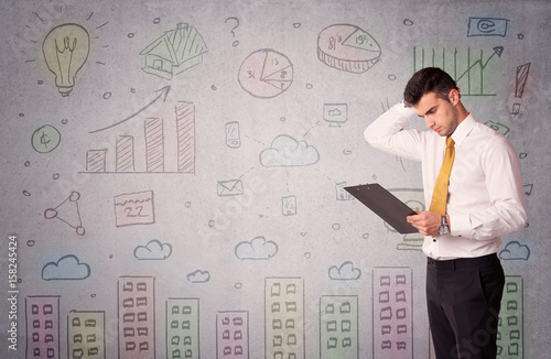 Colorful drawings on wall with businessman