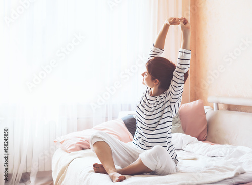 Obraz na płótnie Woman doing yoga in the bed
