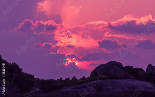 Staande foto Snoeien Landscape of sunset with dramatic sky on background and rock mountain.