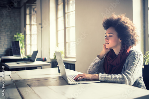Afro-American woman working on computer