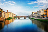 old town with bridge Santa trinita reflecting in water of river Arno, Florence, Italy, retro toned