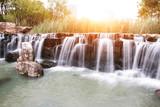 beautiful waterfall with sunbeam