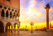 famouse Doge palace, column with winged lion and San Marco square at sunrise, Venice, Italy, retro toned