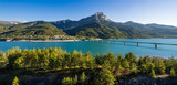 Summer panoramic view of Serre-Poncon Lake with Savines-le-Lac, its bridge and the Grand Morgon mountain peak. Hautes-Alpes, PACA Region, Southern French Alps, France - 158268423