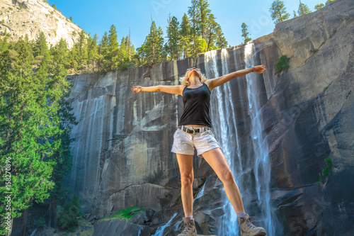 Hiking woman freedom in Yosemite National Park at Vernal Fall on Merced River from Mist Trail
