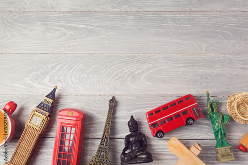 Foto Murales Travel and tourism background with souvenirs from around the world. View from above. Flat lay