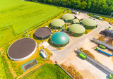 Aerial view over biogas plant and farm in green fields. Renewable energy from biomass. Modern agriculture in Czech Republic and European Union.  - 158290689