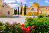 Beautiful monastery with flowers in foreground on Cyprus island