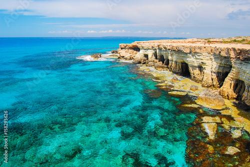Rock cliffs and azure sea water near Cavo Greko peninsula, Cyprus island