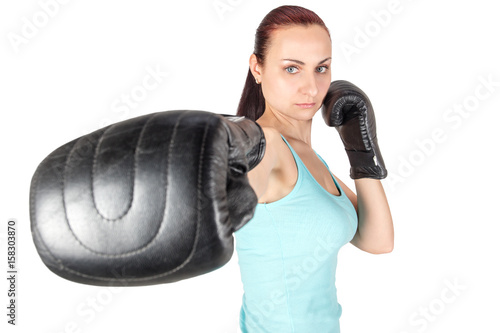 Póster Young athletic woman fights with boxing gloves