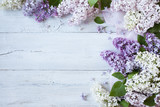 A wooden background with flowering lilac branches - 158305050
