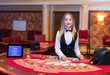 Cute lady casino dealer at Black Jack table.