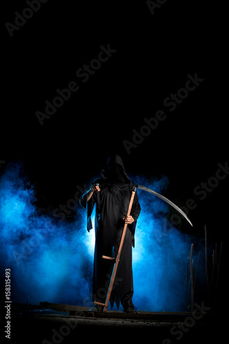 grim reaper with scythe and blue smoke at night pointing finger Poster
