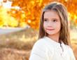 Autumn portrait smiling adorable little girl in the park