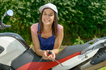 pretty brunette girl in motorbike mechanics