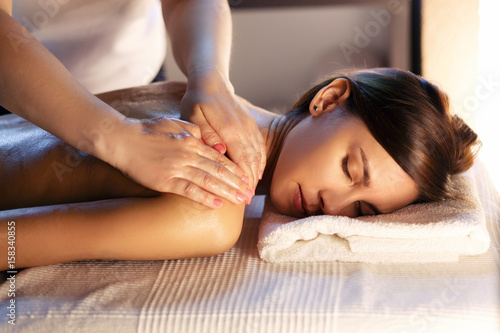 Papiers peints Spa Body massage and spa treatment in modern salon with candles