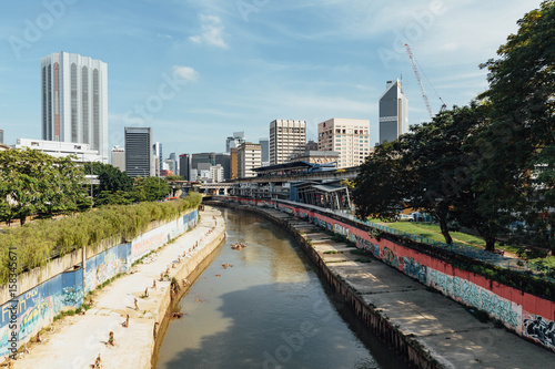 Klang river and cityscape that viewed from sky train station in Kuala Lumpur, Malaysia Poster