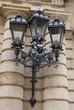 ornamental,metalic street lamp on building