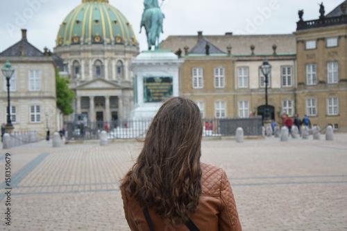 Back view of girl in Amalienborg square Copenhagen, Denmark Poster