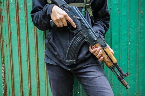 Poster Man hold assault rifles