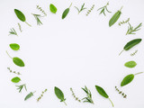 Various fresh herbs from the garden rosemary, sage ,thyme and peppermint leaves flat lay with central copy space on white wooden background. - 158365039