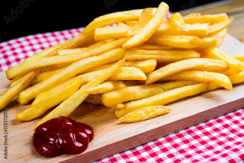 Poster Golden French fries potatoes ready to be eaten