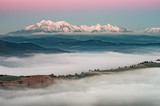 Beautiful spring panorama over misty Spisz highland to snowy Tatra mountains in the morning, Poland