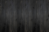 black wooden plank texture background.
