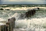 Wooden breakwater in the stormy sea. Seascape, Baltic sea near Klaipeda, Lithuania.