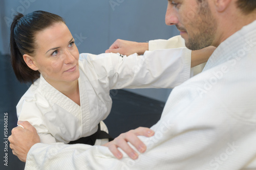 Man and woman in karate combat Poster