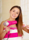 Beautiful fresh young girl wearing pink towel and drying her hair