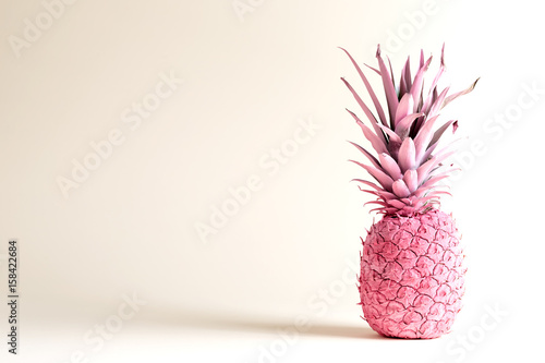 Pink painted pineapple on a white background