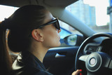 Woman driving car close-up