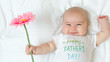 Baby girl holding a flower - 158426058