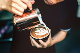 How to make latte art by barista focus in milk and coffee in vintage color tone.