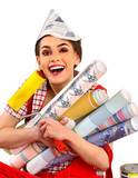 Repair home woman holding paint roller for wallpaper. Aggressive screaming girl in newspaper cap renovation apartment on isolated. Girl is glad to choose right materials.