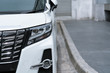 headlight of white modern car on the road