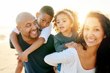 Happy black family with children on beach