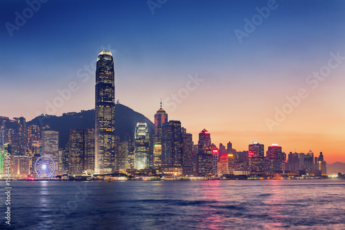 Poster Hong Kong island and business downtown at twilight scene.