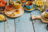 Cups with herbal tea and pieces of lemon, dried herbs and different decorations - 158453002