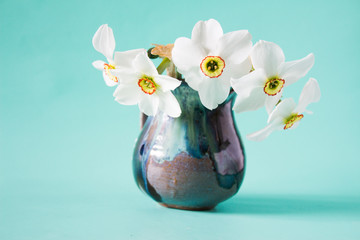 Bouquet of white daffodils in vintage vase. Spring Flower. Narcissuses on neutral background. Romantic gift.