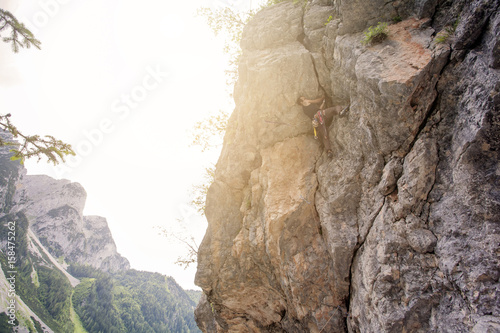 Poster Landscape of Gosau Valley mountain with a male climber