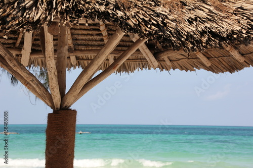 Fotobehang Zanzibar Thatched Parasol / Traditional thatched parasols are useful places for resting in the shadow on Zanzibar Island, Africa