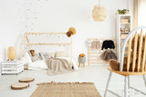 Fototapeta Scandinavian bedroom with eco-friendly accessories