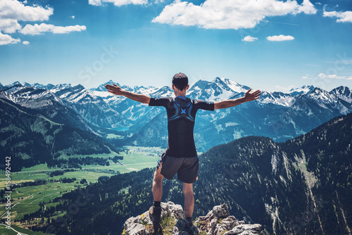 Foto op Canvas Zen Hiker celebrating nature and reaching the summit
