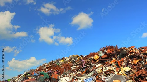 Staande foto Industrial geb. timelapse of background of clouds on ferrous scrap