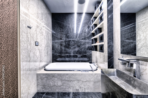 Fototapeta Black-and-white marble in the interior of a modern bathroom in a luxury apartment.