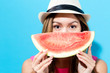 Happy young woman holding watermelon